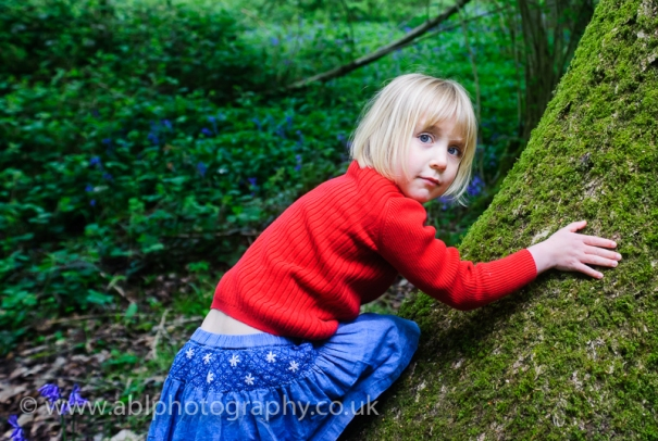 Bluebell photo-shoot by ABL Photography- girl in red on a tree